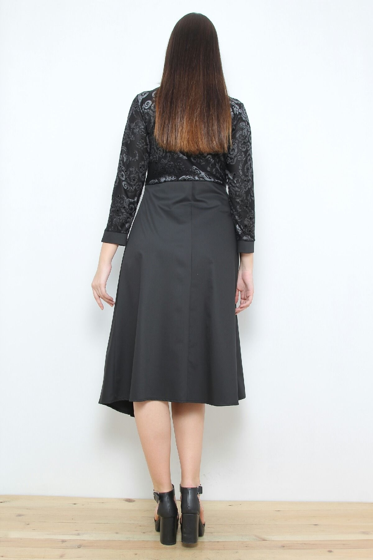 Dress with lace detail and asymmetric bottom