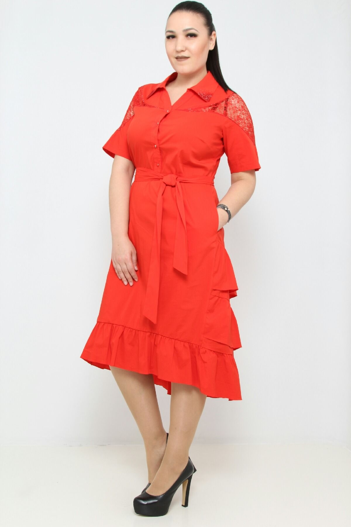 Under knee length party dress with  short sleeves and shoulders with lace, stoned and buttoned neckline, with belt and pockets, asymmetrical skirt with pleated ruffles at back